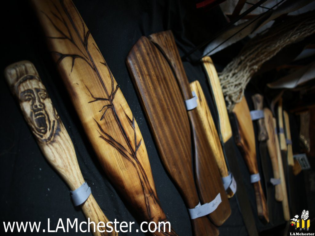 Hand carved wooden paddles at LAMchester